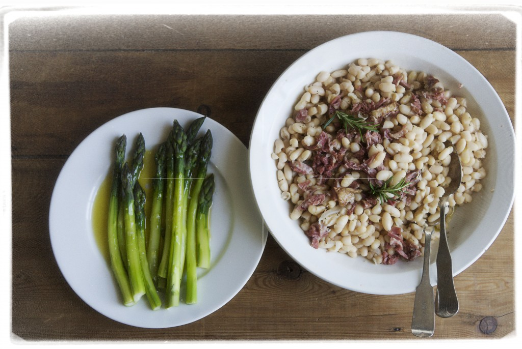 Cannellini beans cooked with smoked ham and rosemary, and fat asparagus dressed with a really good olive oil